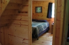 Bedroom In Woodland Cabins